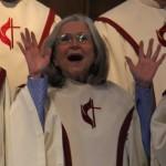 Choir woman robe hands raised